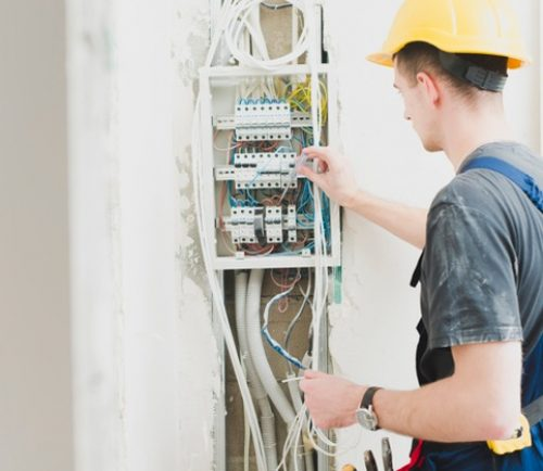 electrician-working-with-switchboard_23-2147743117